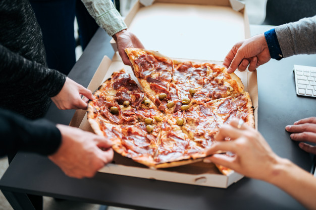 business people sharing pizza